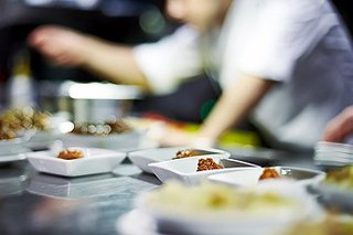 Plating up food in catering setting